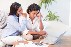 Frustrated couple underestimated their expenses Stock Image
