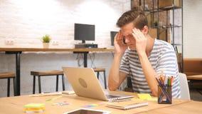 Frustrated Creative Designer Working on Laptop Computer, Headache stock photos