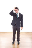 Frustrated and depressed businessman with headache holding his h Royalty Free Stock Photography