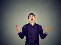 Frustrated desperate young man screaming stock images