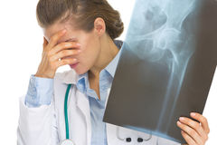 Frustrated doctor woman holding fluorography Stock Images