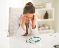 Frustrated doctor woman in office Royalty Free Stock Image