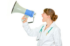 Frustrated doctor woman yelling through megaphone Stock Image