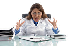 Frustrated doctor in workplace Stock Images