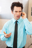 Frustrated executive on cell phone Royalty Free Stock Images