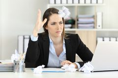 Frustrated executive throwing a paper ball. Frustrated executive without inspiration throwing a paper ball at office Royalty Free Stock Photos
