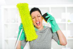 Frustrated and exhausted cleaning woman screaming Stock Image