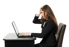Frustrated young businesswoman at her laptop Stock Photo