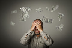 Frustrated. Falling dollars. Royalty Free Stock Photography