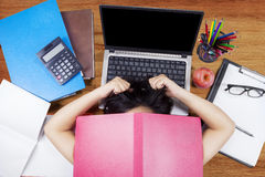 Frustrated female college student studying Royalty Free Stock Photography
