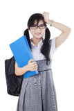 Frustrated female learner standing in studio Stock Photo