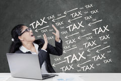 Frustrated female manager paying tax Royalty Free Stock Images