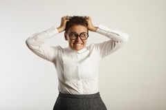 Frustrated female teacher in conservative clothes stock images