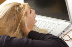 Frustrated Female Using Laptop Stock Photo