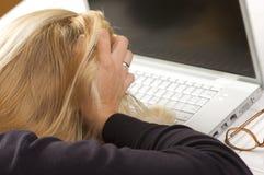 Frustrated Female Using Laptop stock photo