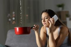 Frustrated girl calling insurance about water leaks Royalty Free Stock Image