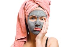 Frustrated girl with facial mask, mask for skin woman, funny girl, photo, girl is waiting until the mask for the skin stock image