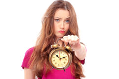 Frustrated girl holding an alarm clock Stock Images