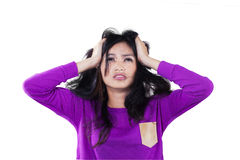 Frustrated girl holding her head Royalty Free Stock Images