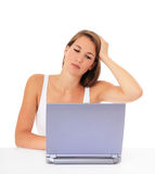 Frustrated girl with laptop Royalty Free Stock Photo