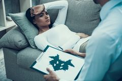 Frustrated girl at psychologist office. Rorschach test. Psychotherapy concept Royalty Free Stock Images