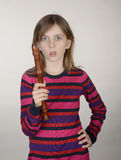 Frustrated girl with recorder Stock Image