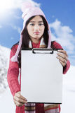 Frustrated girl showing empty clipboard Stock Photo