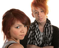 Frustrated Girlfriend. Annoyed girlfriend with frustrated boyfriend in mohawk Stock Photography