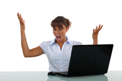 Frustrated with her laptop Royalty Free Stock Images