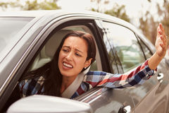 Frustrated Hispanic female driver in a car Royalty Free Stock Photo