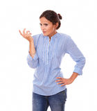 Frustrated hispanic woman asking a question Royalty Free Stock Images