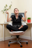 Frustrated home office worker in yoga postion Royalty Free Stock Photo
