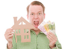 Frustrated houseowner with money Royalty Free Stock Image