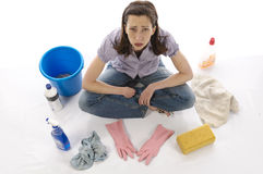 Frustrated housewife with cleaning Royalty Free Stock Photography