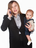 Frustrated Lady on Phone with Baby Stock Photography