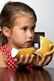 Frustrated little girl with a broken cup Royalty Free Stock Photography