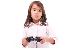 Frustrated little girl gamer experiencing game over Stock Photos