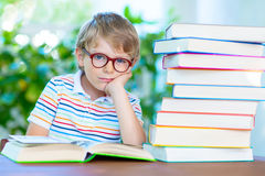 Frustrated little schoolboy with glasses and books Royalty Free Stock Photo