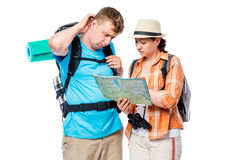 Frustrated lost tourists with map isolated on white. Background Royalty Free Stock Photo