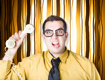Frustrated male office worker yelling with phone Royalty Free Stock Image