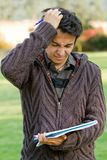 Frustrated male student Royalty Free Stock Images