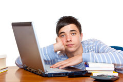 Frustrated male teenage student learns on computer Stock Photos