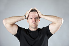 Frustrated man. Stressed, frustrated man with hands on his head stock photos