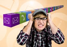 Frustrated man against application icons in background Royalty Free Stock Image