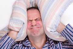 A frustrated man in bed Stock Photos