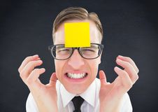 Frustrated man with blank sticky note on forehead Stock Photography