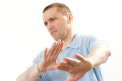 Frustrated man in a blue  on a white Stock Photos