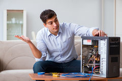 The frustrated man with broken pc computer Stock Image