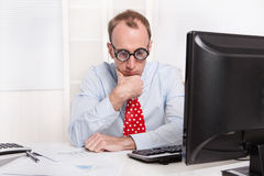 Frustrated man with burn-out syndrome - sad sitting at his table Royalty Free Stock Image