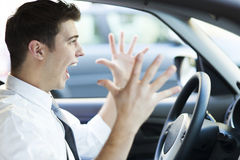 Frustrated man driving car stock photo